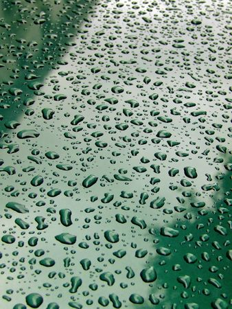 qua: A lot of little raindrops on green surface Stock Photo