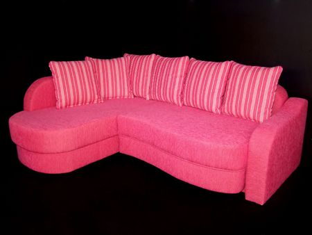 Beautiful pink sofa with lot of strapped pillows Stock Photo - 697374