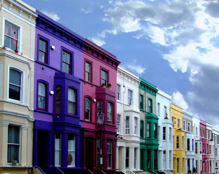 outside of house: Multi color residental buildings in a row