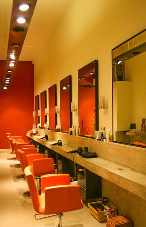 Modern red interior of hair dresser saloon photo