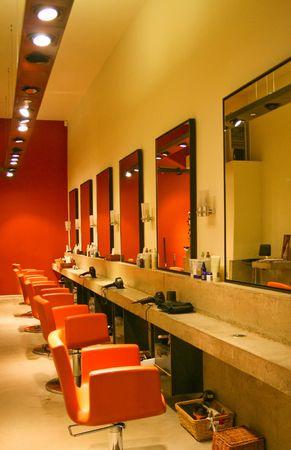 Modern red interior of hair dresser saloon photo
