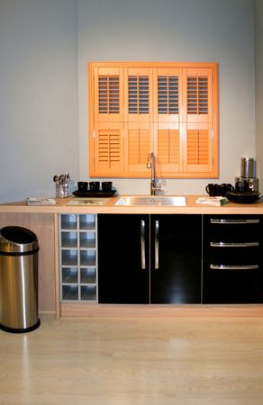 big bin: Modern small black kitchen with brown window Stock Photo