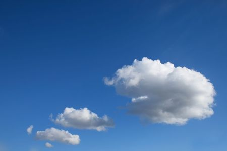atmospheric phenomena: Tree white clouds over clear blue sky