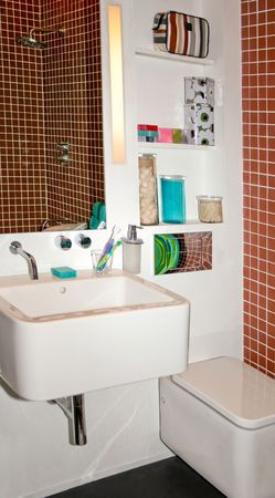 Modern terracotta colored bathroom with white elements photo