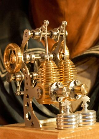 Working model of gold plated sterling engine photo