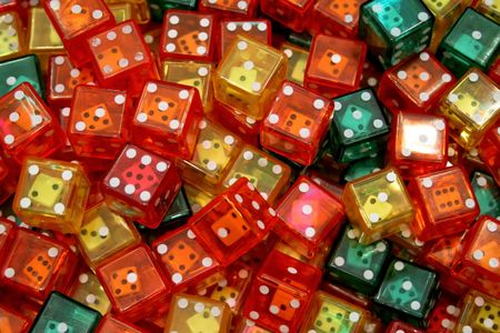 Bunch of plastic dices with another dice inside photo