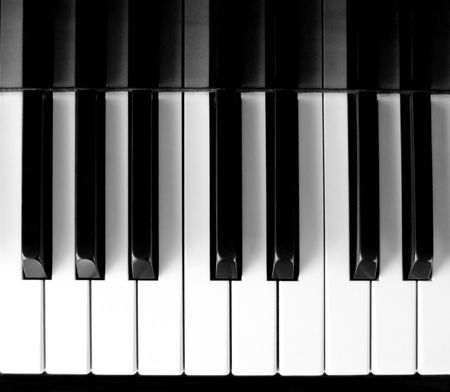 Top view of classic piano key press photo