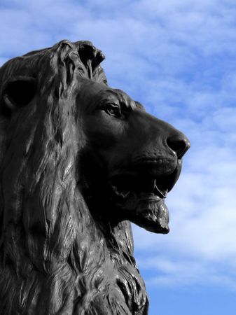 Big and dangerous African lion head statue photo
