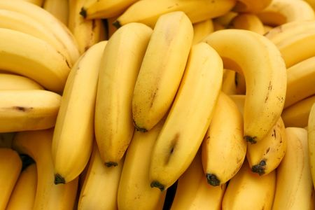 A bunch of organic and yellow bananas photo