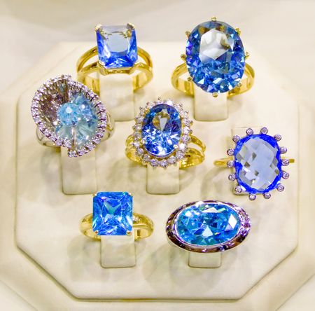 Beautiful collection of gold rings with blue diamonds