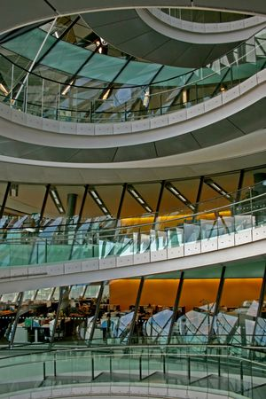 Spiral stairway with modern offices and reflections  photo