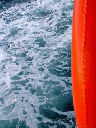 Orange life saver with wavy ocean in background Stock Photo - 953435