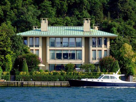 Luxurious coast villa with beautiful motor yacht photo