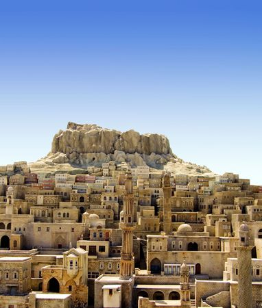 flecks: Old medieval Middle East city on the hill
