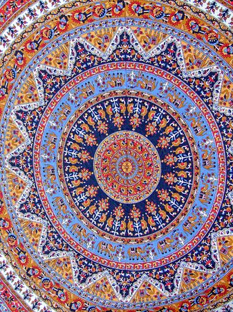 Round carpet with floral and elephants decoration photo