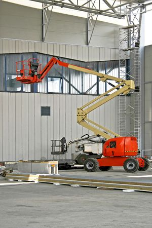 Red construction crane in big industrial hall photo