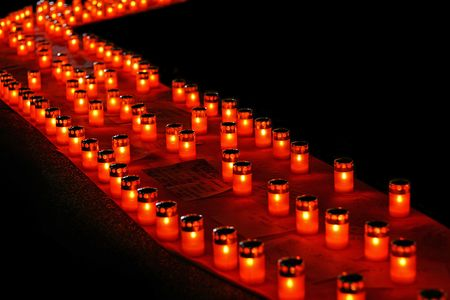 A lot of red candles in line photo