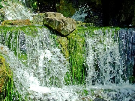 Mountain green water falls with white froth Stock Photo - 1350085