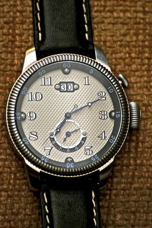 analogue: Chrome analogue watch with perforated dial close up