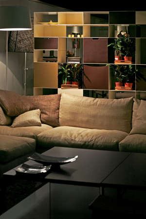 Night view of sofa and shelf in living room Stock Photo