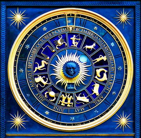 Blue zodiac clock with gold deatail and decoration photo