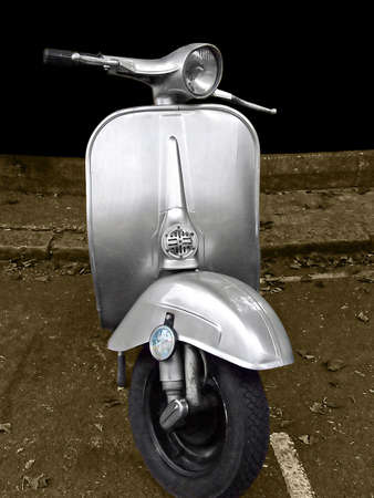 motor scooter: Front view of retro style scooter sepia