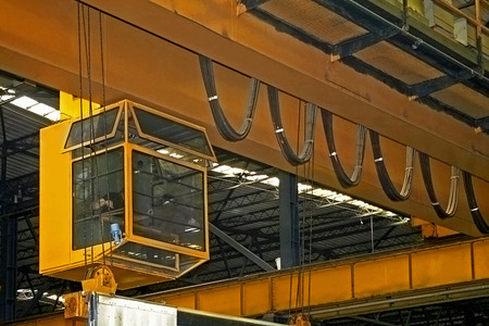 whooping: Big yellow crane lifter for heavy load Stock Photo