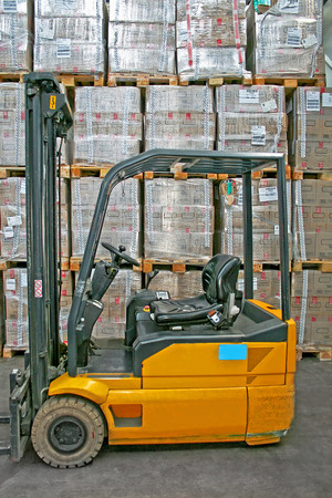 lifter: Yellow fork lifter truck and cargo boxes