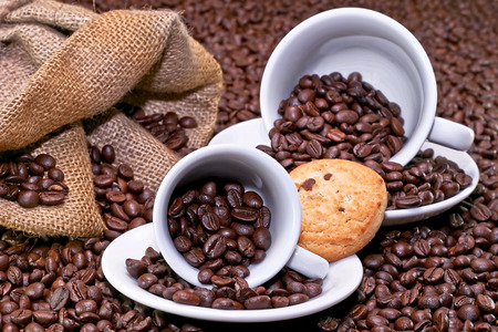 Two coffee cups with cookie with background photo