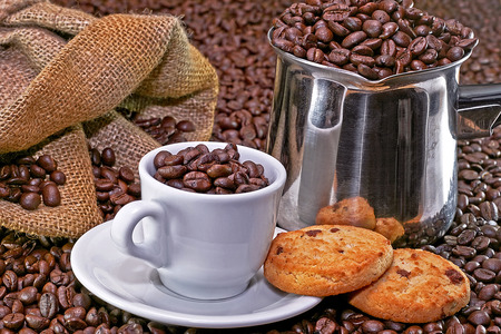 Small coffee cup and cookies with background photo