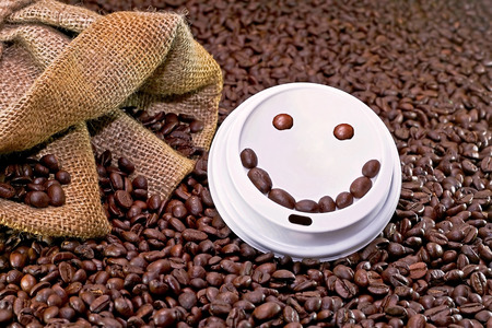 Smiley face on the top of take away coffee cup photo