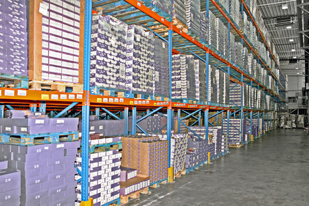 Big warehouse storage room with boxes and shelves photo