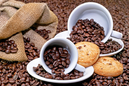 Two coffee cups with cookies with background photo