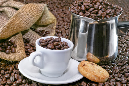 Small coffee cup and cookie with background photo