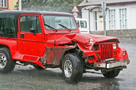 Crashed red SUV in traffic terrific accident