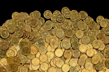 Bunch of golden coins ten close up Stock Photo