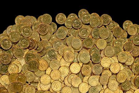 pound coin: Bunch of golden coins ten close up Stock Photo