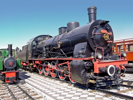 Small and big locomotive train on the tracks  Stock Photo - 1798375