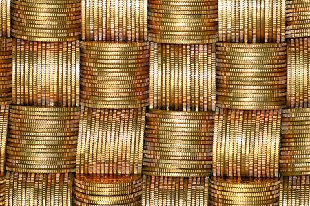Bunch of golden money coins close up photo