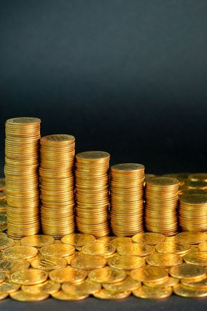 Descending chart made of golden money coins Stock Photo - 1874220