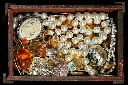 Bunch of jewellery and gold in the chest photo