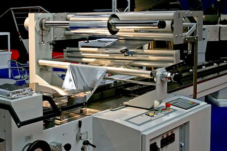 Automated packaging machine for aluminum foil packs