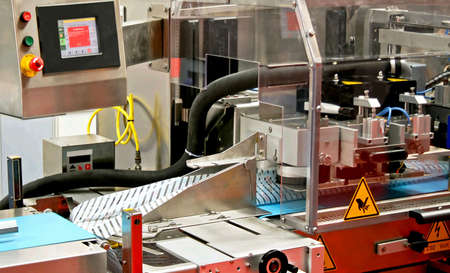handling: Close up shot of automated packaging machine Stock Photo