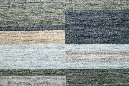grey rug: Blue and grey rug made from wool Stock Photo