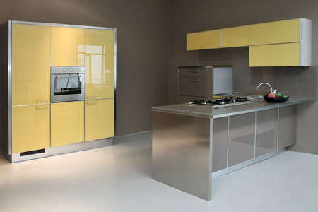 New modern kitchen in yellow with metal  photo