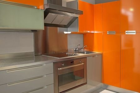 New modern kitchen in orange with metal Stock Photo - 2056704