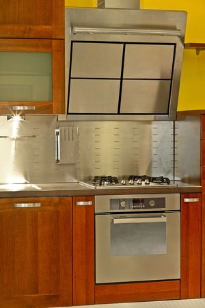 Modern stainless steel stove and kitchen ventilation Stock Photo - 2056707
