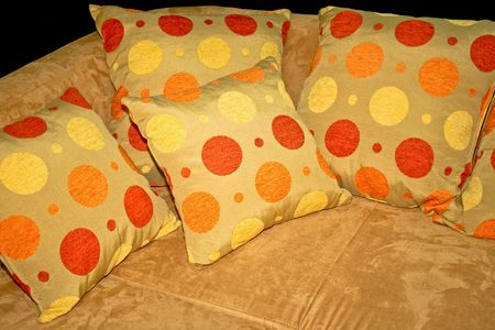 Soft pillows with dots and plush sofa Stock Photo - 2065605