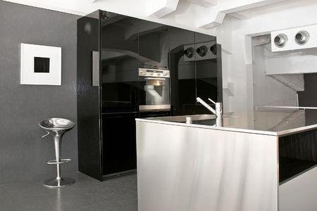 kitchen renovation: Minimalism design of modern big black kitchen Stock Photo