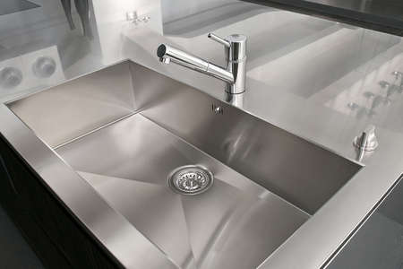Angle view of kitchen sink and silver faucet